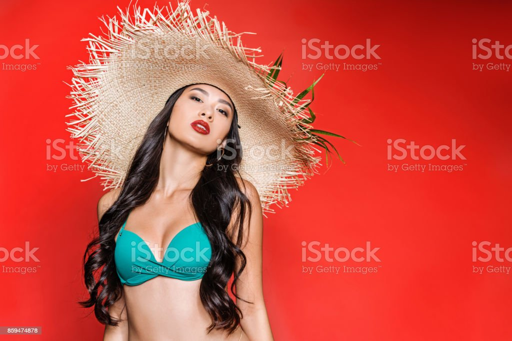 37d207a4c7 Asian Woman In Swimsuit And Straw Hat Stock Photo & More Pictures of ...