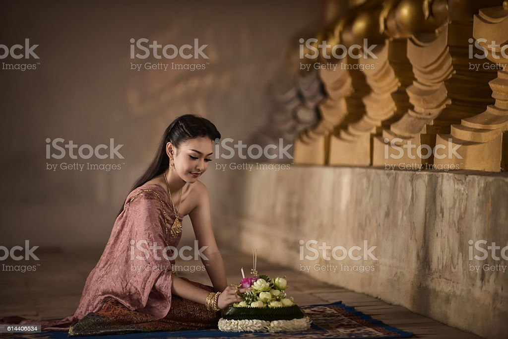 Asian woman in Thai dress traditional stock photo