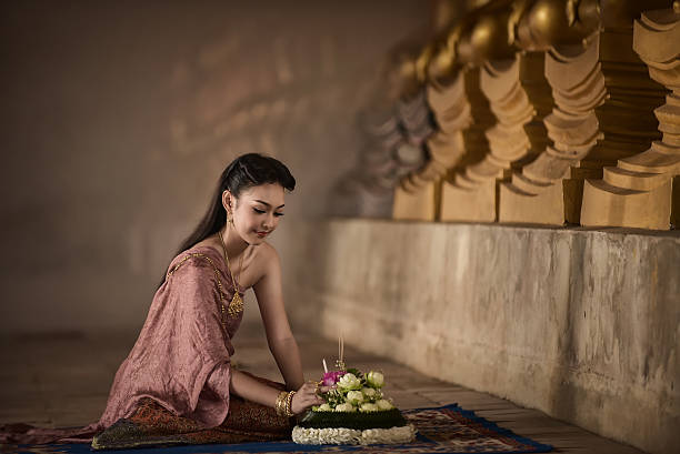 asian woman in thai dress traditional - kratong stock photos and pictures
