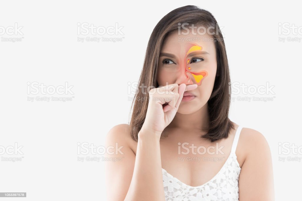 Asian woman in white wear feeling unwell and sinus against white  background, Dust Allergies, Flu, People caught cold and allergy - Stock  image .