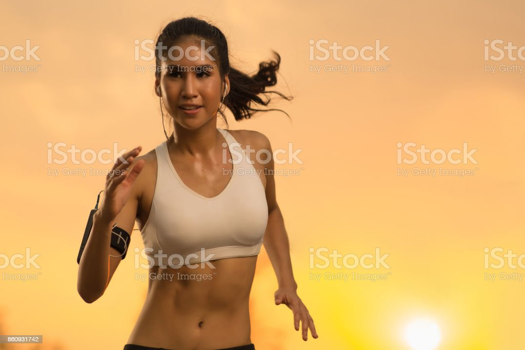 Asian woman jogging in the evening stock photo