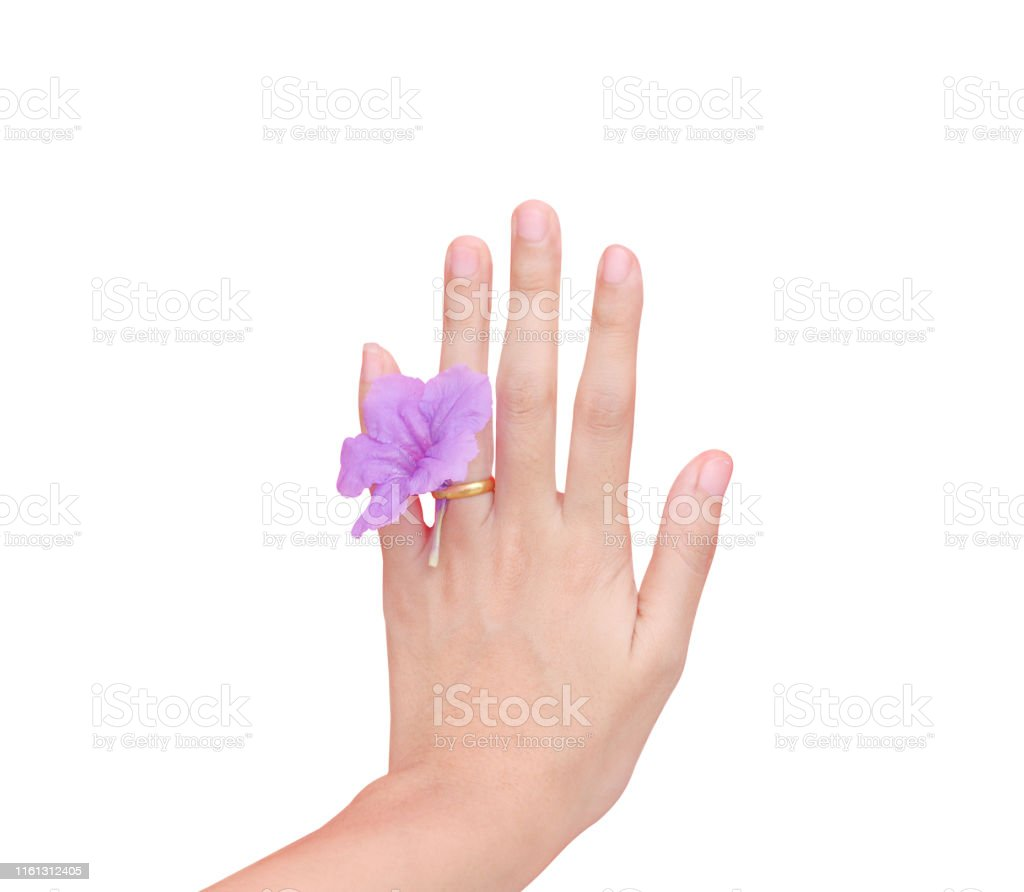 Asian woman left hand wearing gold ring with single colorful purple...