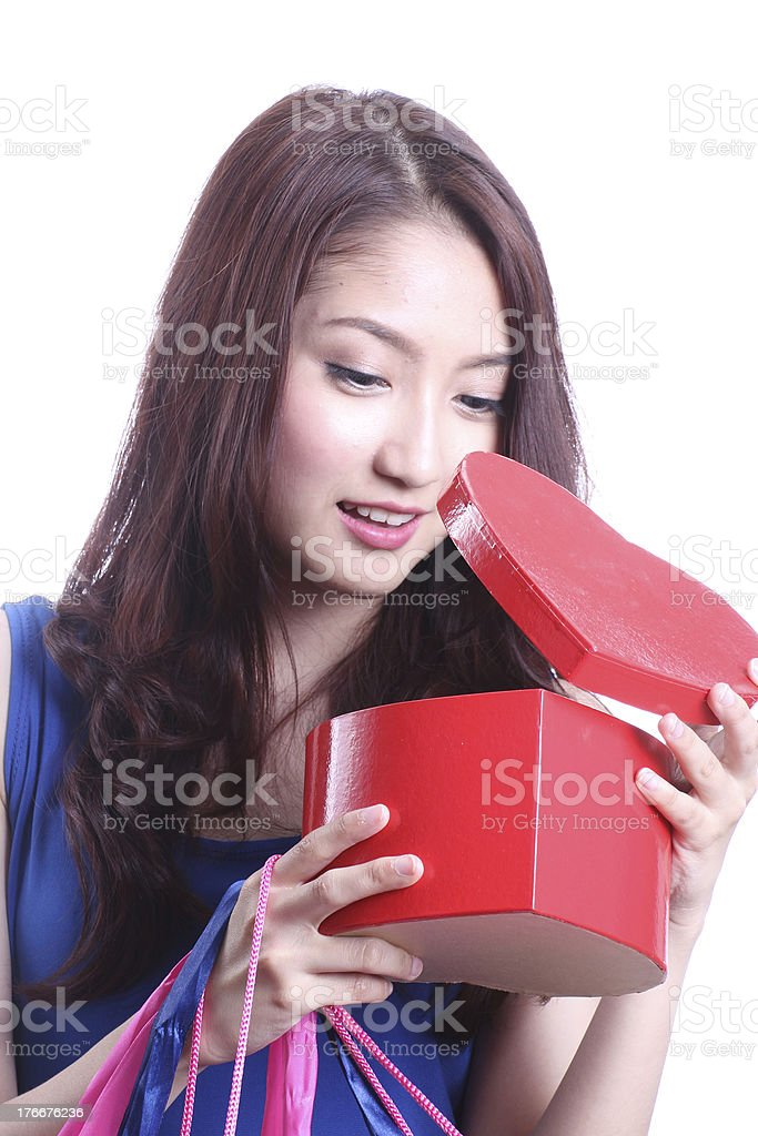 Asian woman looking a chocolate box royalty-free stock photo