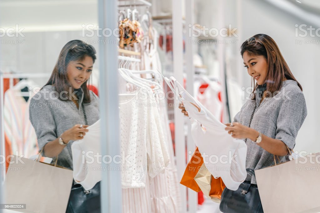 5d8ff5f83 Asian woman looking and choosing the underwear in store shop with happy  action at department center - Stock image .