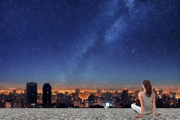 Asian woman looking on night city stock photo