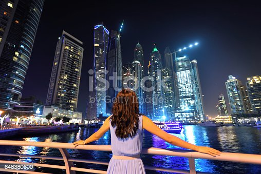 Asian woman looking the cityscape of Dubai