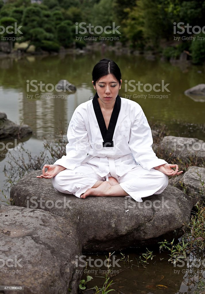 Asian woman meditating royalty-free stock photo