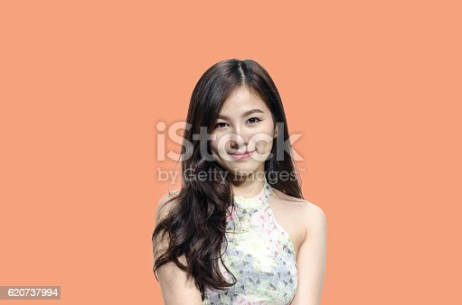 istock Asian woman model smiling with dimple long hair 620737994