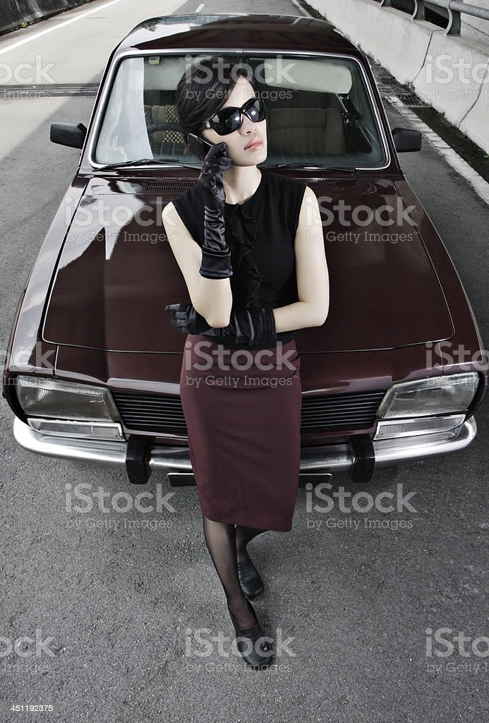Asian Woman On Mobile With Car stock photo