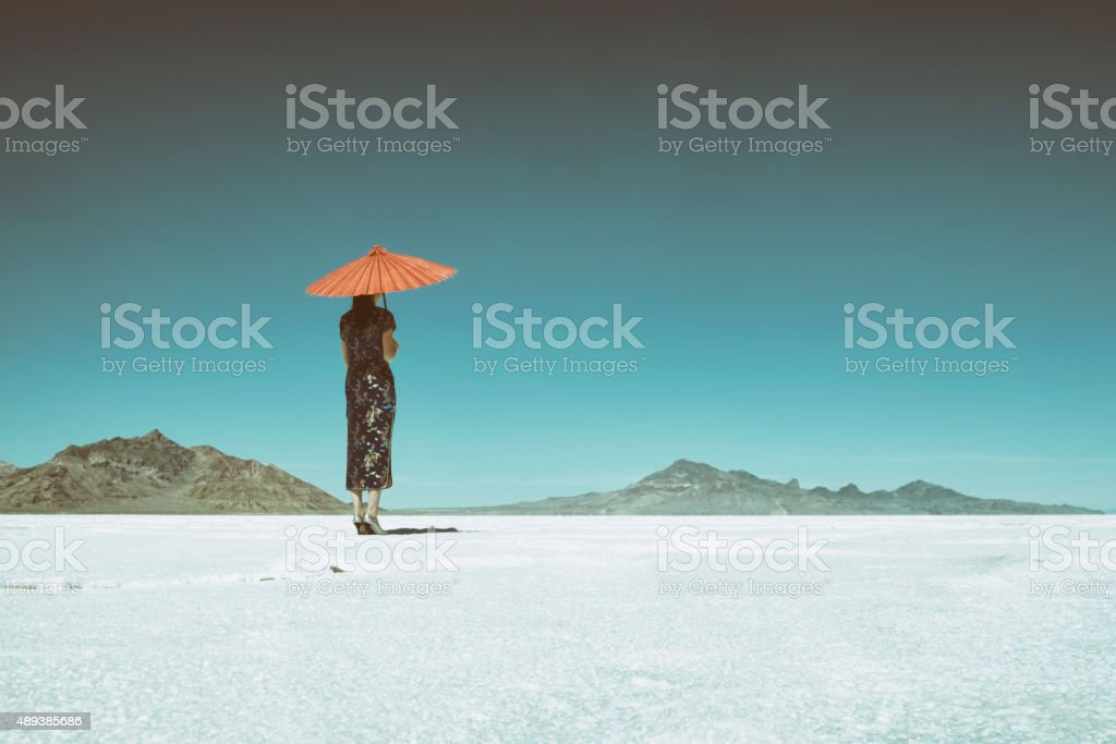 Asian Woman on Salt Flats stock photo