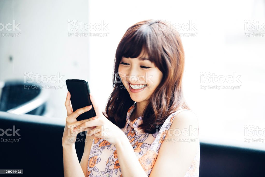 Asian woman on the phone stock photo