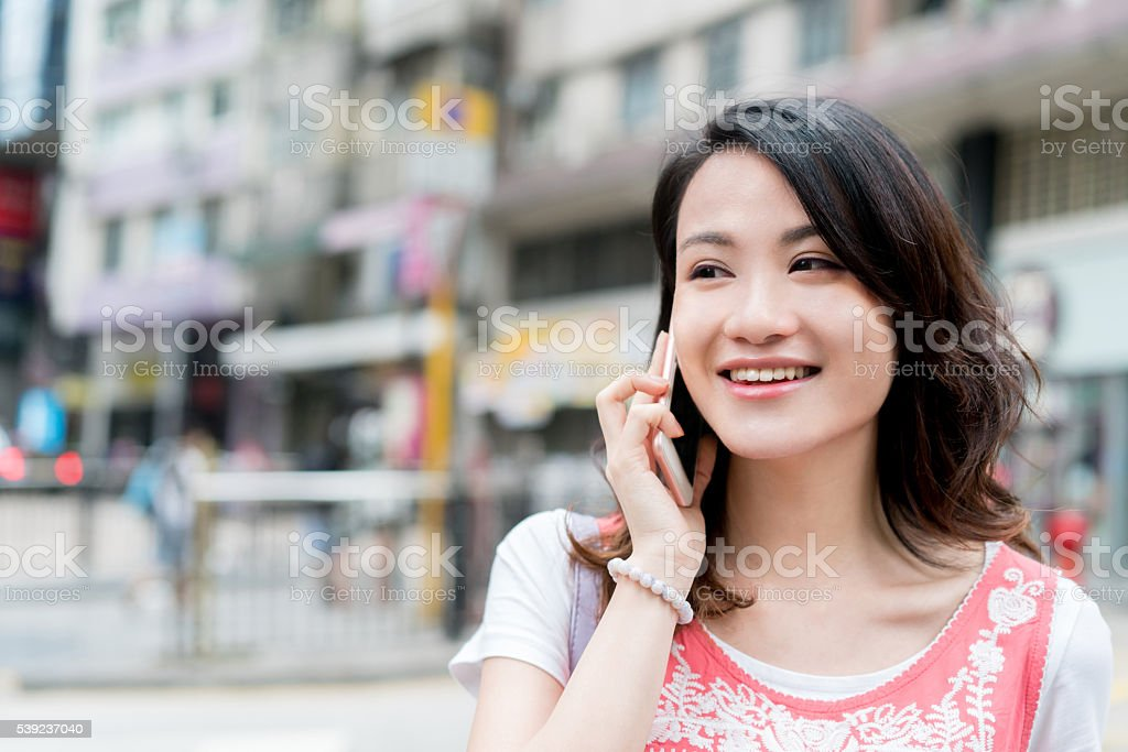 Asian woman on the phone royalty-free stock photo