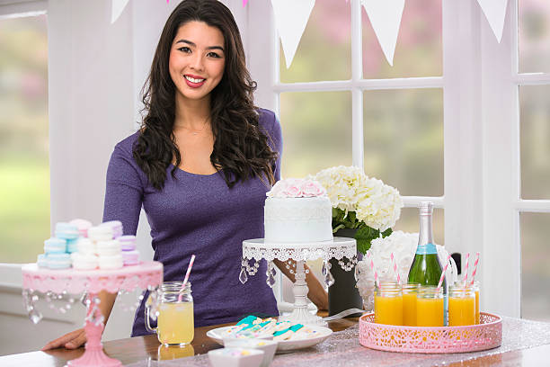 asian woman party decoration setting table food drink pastel theme - mimosa cake foto e immagini stock