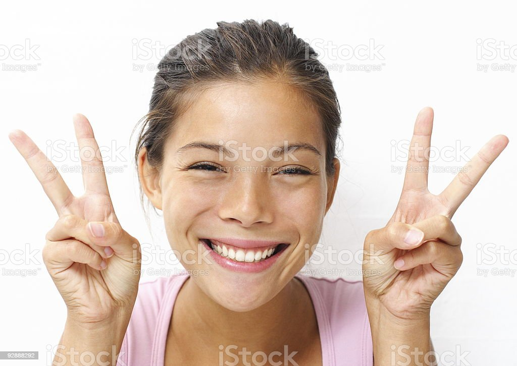Asian woman peace hand sign stock photo