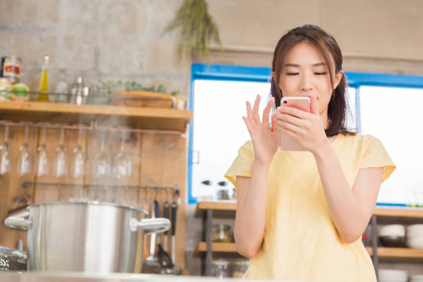 asian woman - stay at home parent stock pictures, royalty-free photos & images