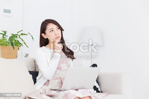 istock asian woman 1166920858