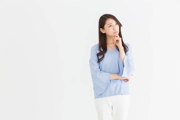 asian woman young attractive asian woman who thinks worried stock pictures, royalty-free photos & images