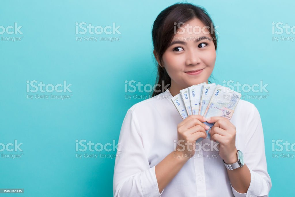 Asian woman planing to use fifty baht banknote stock photo