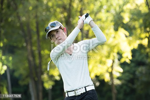 istock Asian woman playing golf on a beautiful natural golf course 1134417526