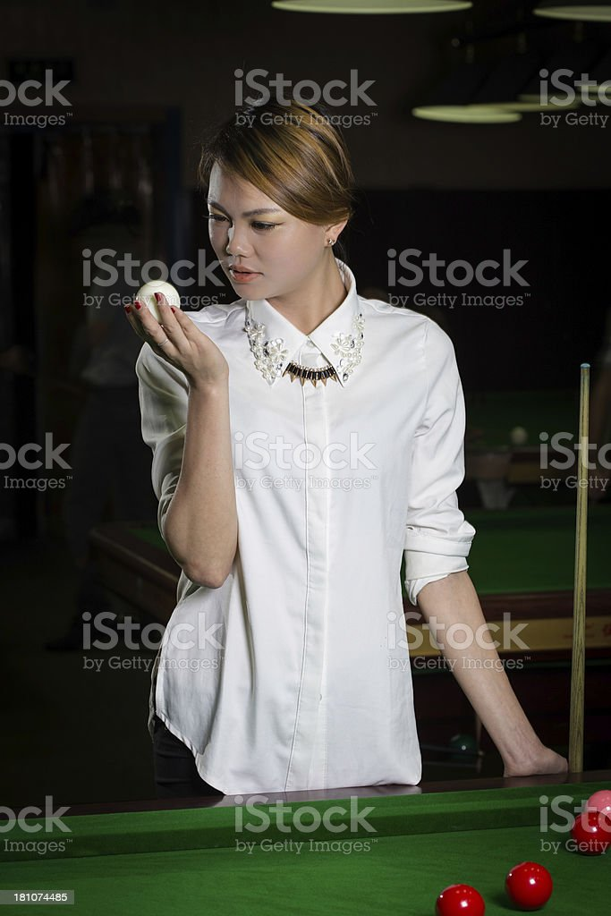 asian woman playing pool royalty-free stock photo
