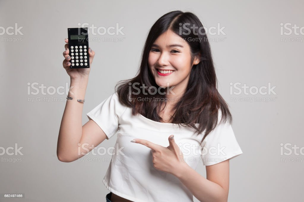 Asian woman point to  calculator. royalty-free stock photo