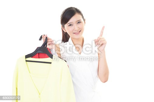 istock Asian woman pointing 630053170