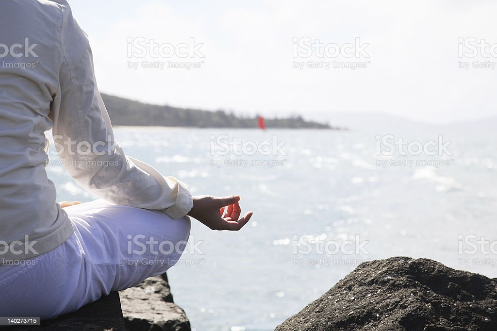 Asian woman practices Yoga royalty-free stock photo