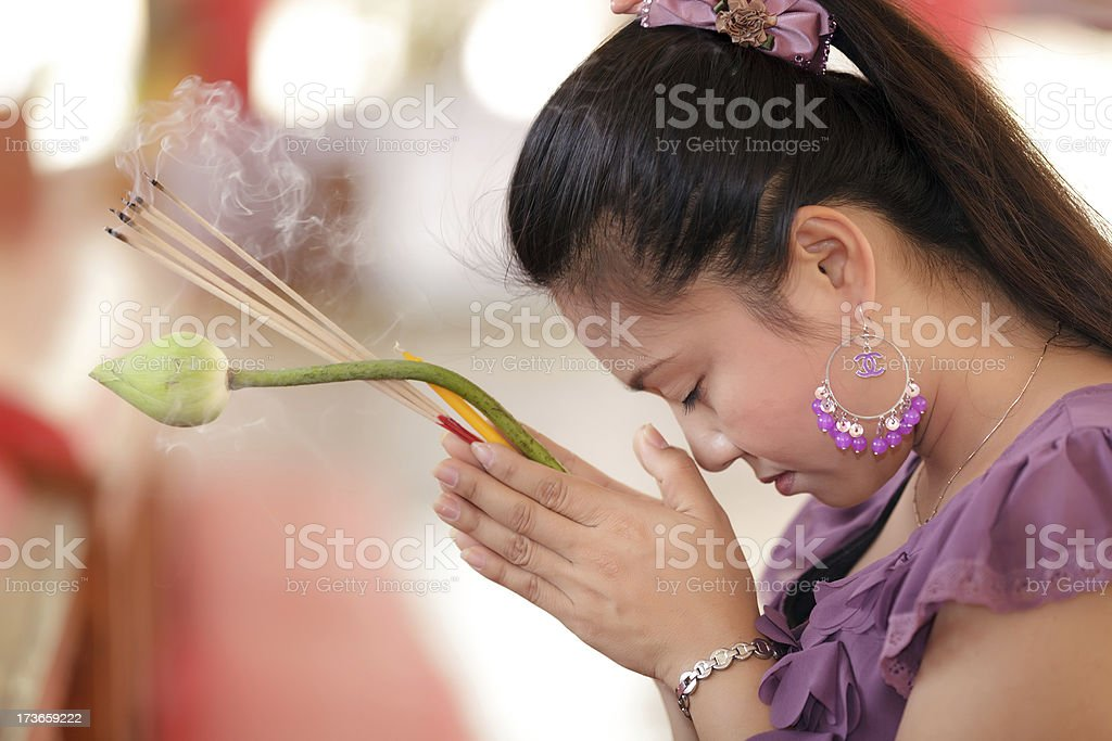 asian woman praying stock photo