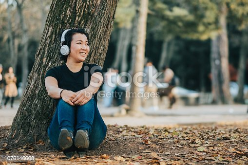 Asian woman relaxing and listening to music