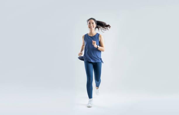Asian woman run marathon studio white background. stock photo