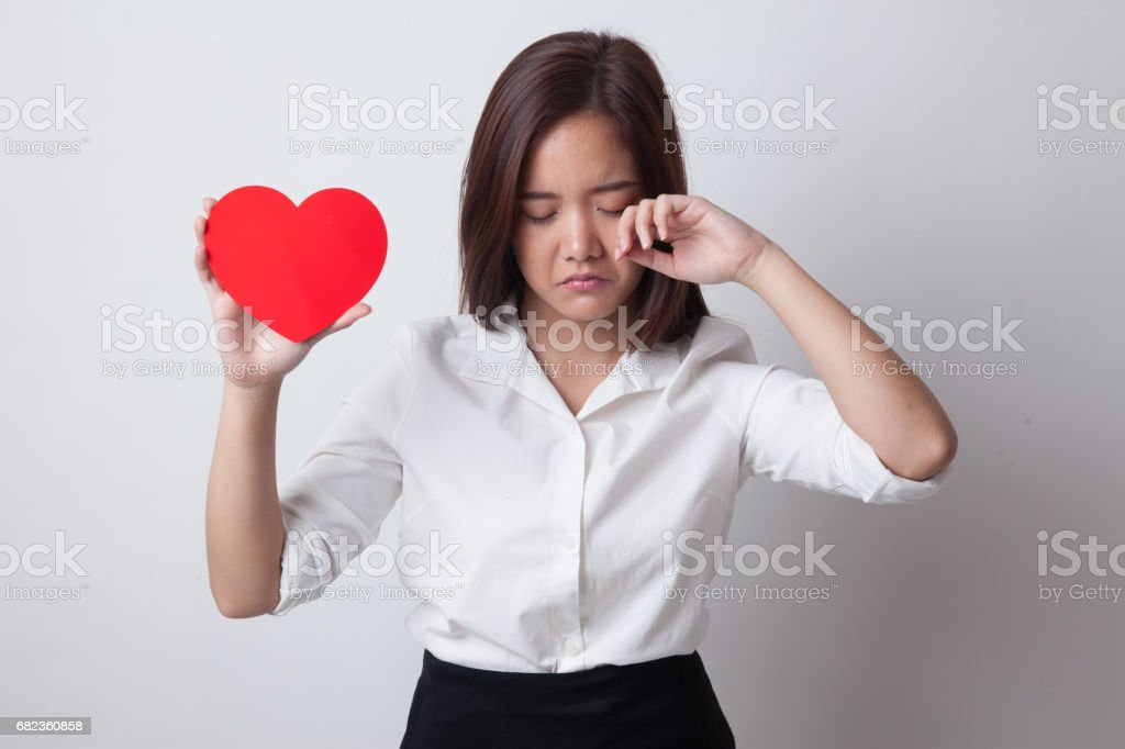 Asian woman sad and cry with red heart. foto stock royalty-free