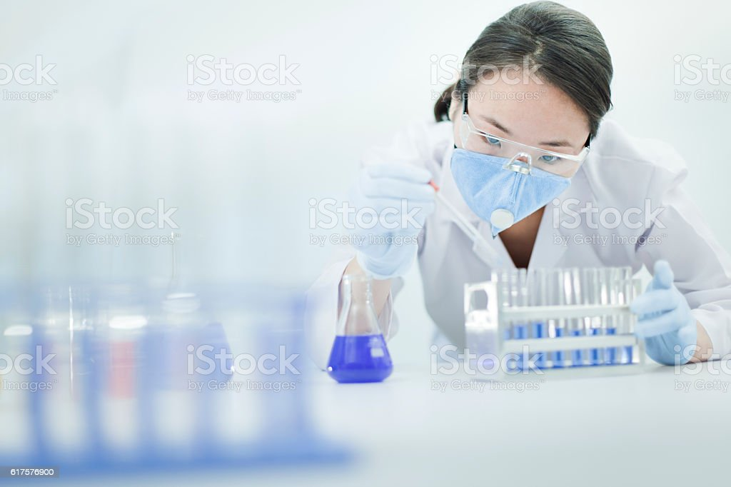 Asian woman scientist working with chemical in a laboratory. stock photo