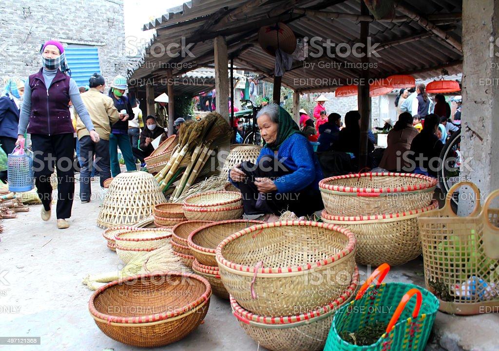 Asian woman selling bamboo basket at market stock photo