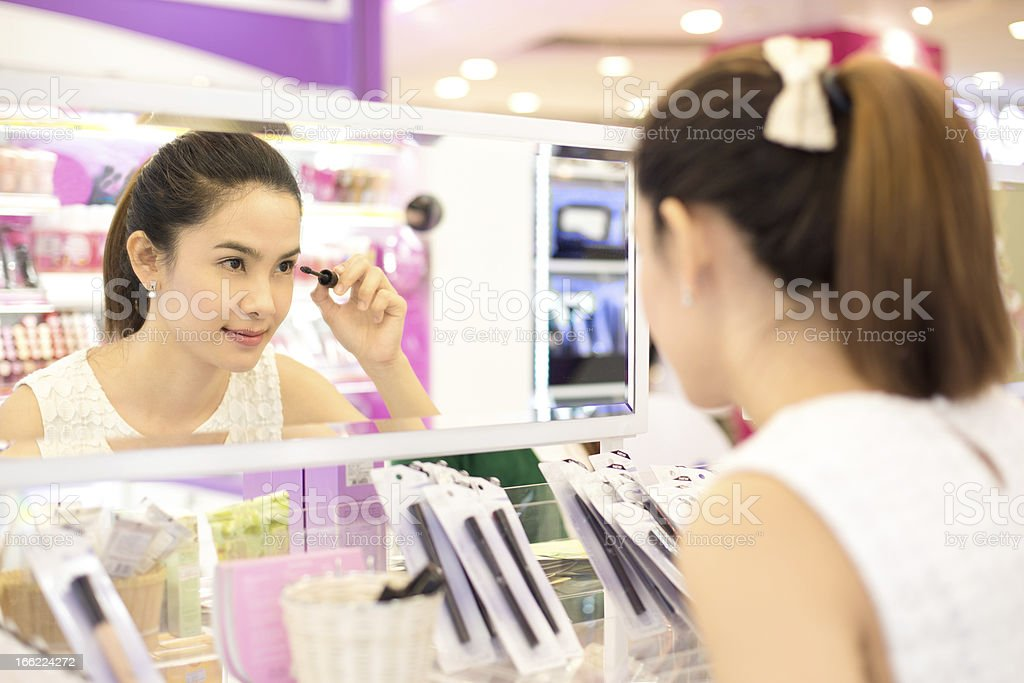 Asian woman shopping in the store cosmetics. royalty-free stock photo