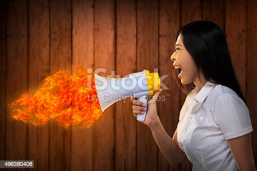 istock Asian Woman Shouting Megaphone On Fire 496380408
