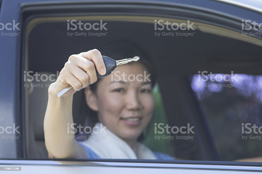 asian woman show a key's car royalty-free stock photo