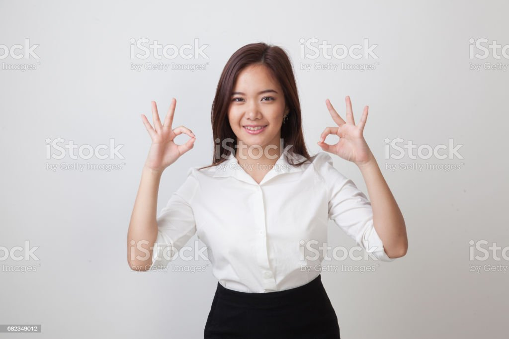 Asian woman show double OK hand sign  and smile. foto stock royalty-free