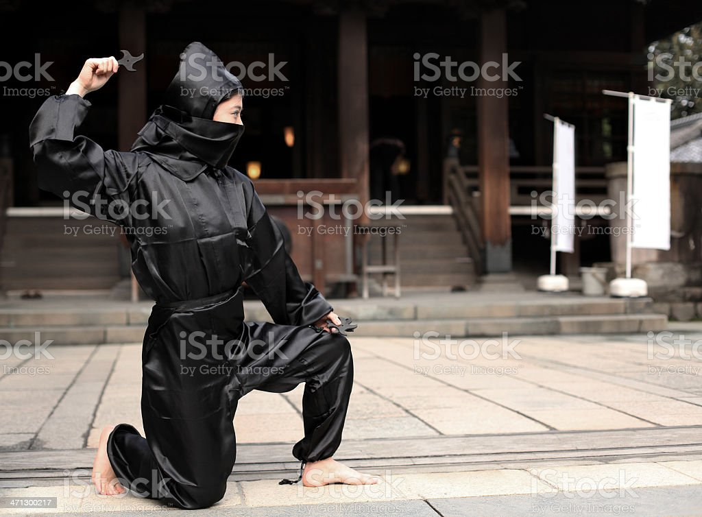 Asian woman showing her ninja look stock photo
