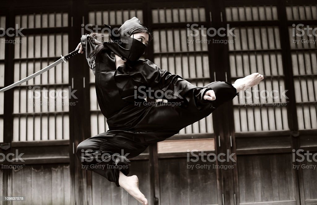 Asian woman showing her ninja moves stock photo