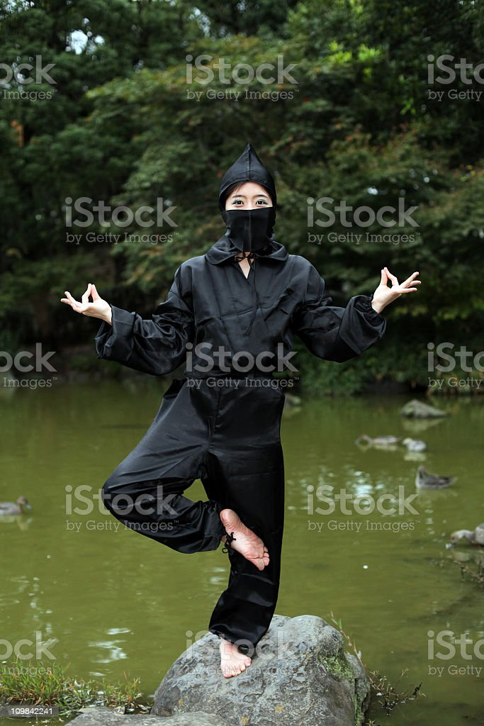 asian woman showing her ninja moves stock photo more pictures of