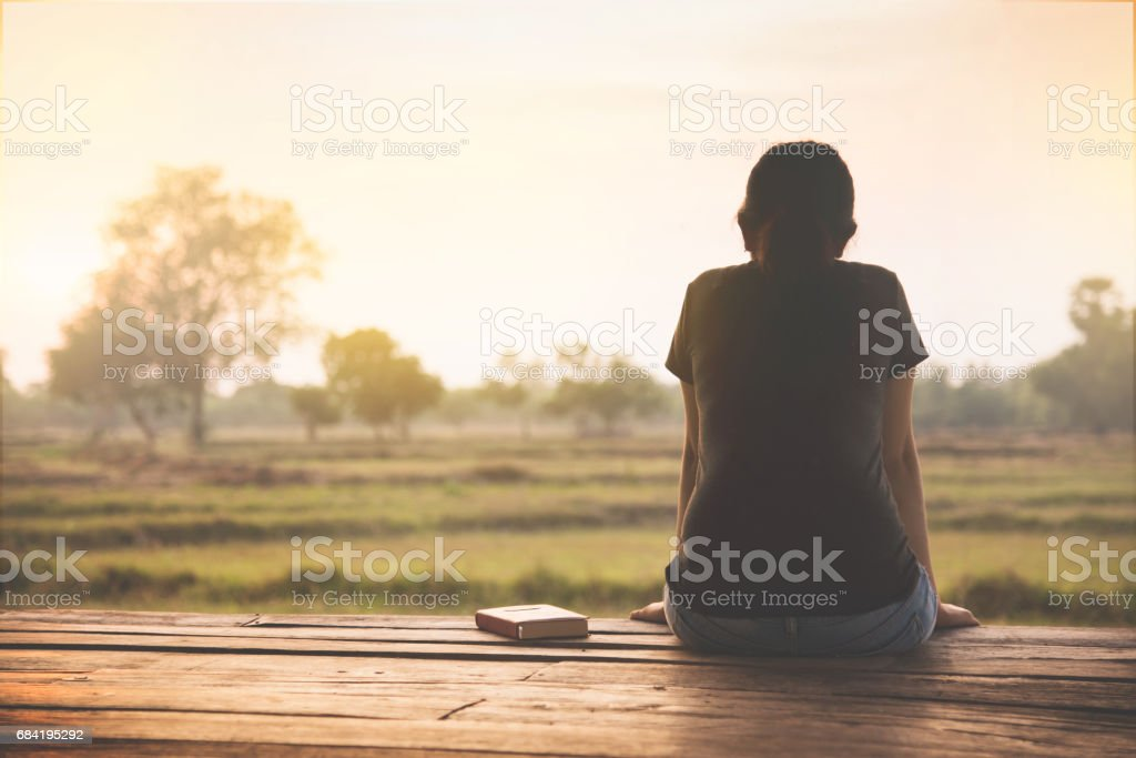 Asian woman sitting on countryside background in the morning. royalty-free stock photo