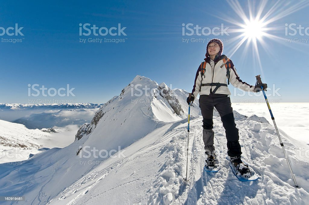 Asian woman skiing on a clear sunny day stock photo