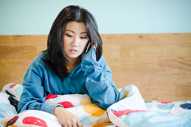 Asian woman Smile face and she wake  on the bed stock photo