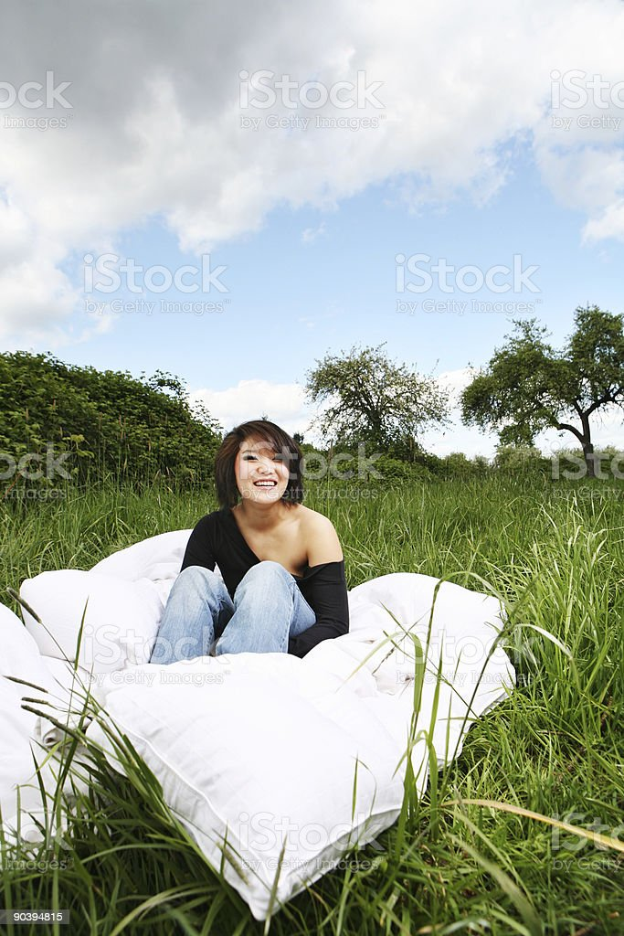 Asian Woman Smiling in a Meadow royalty-free stock photo