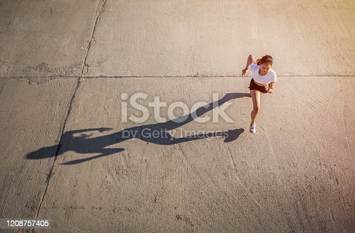 Top view of Asian Woman sprinting and runner working out in the city road