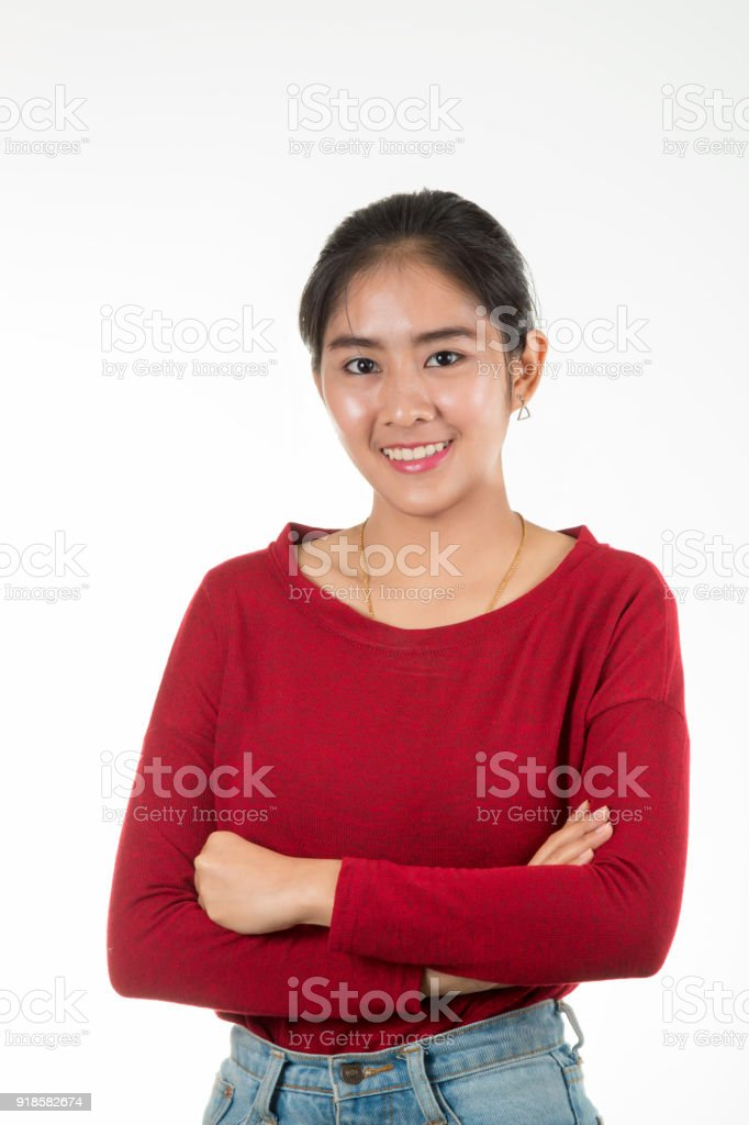 Asian woman standing by crossing her arm on white background; Confidential Thai teenage stock photo