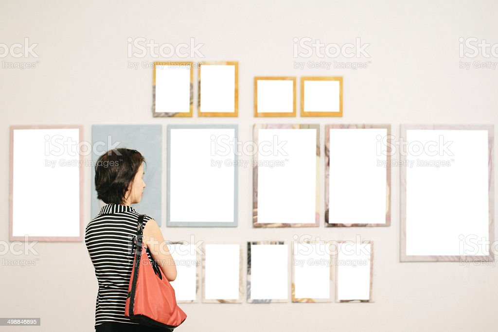 Asian woman standing in an art gallery stock photo