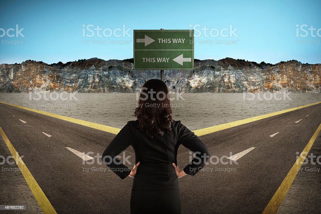Asian woman standing in the middle of cross road stock photo