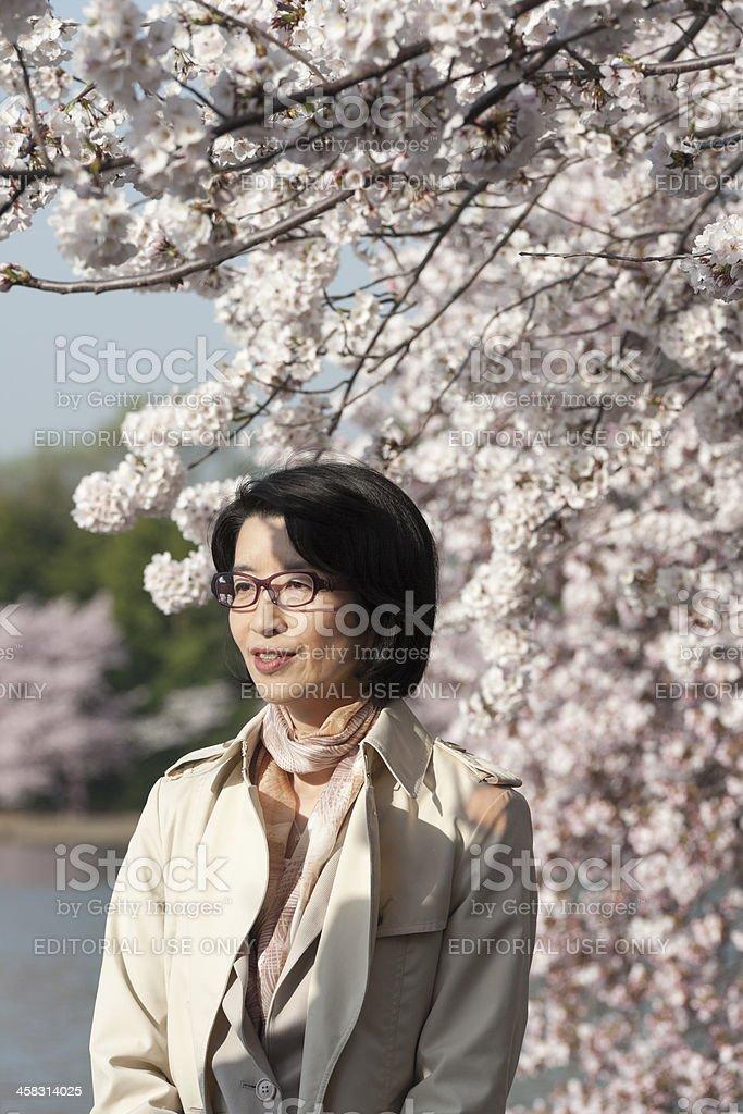 asian woman standing in the sun at tidal basin, washington royalty-free stock photo