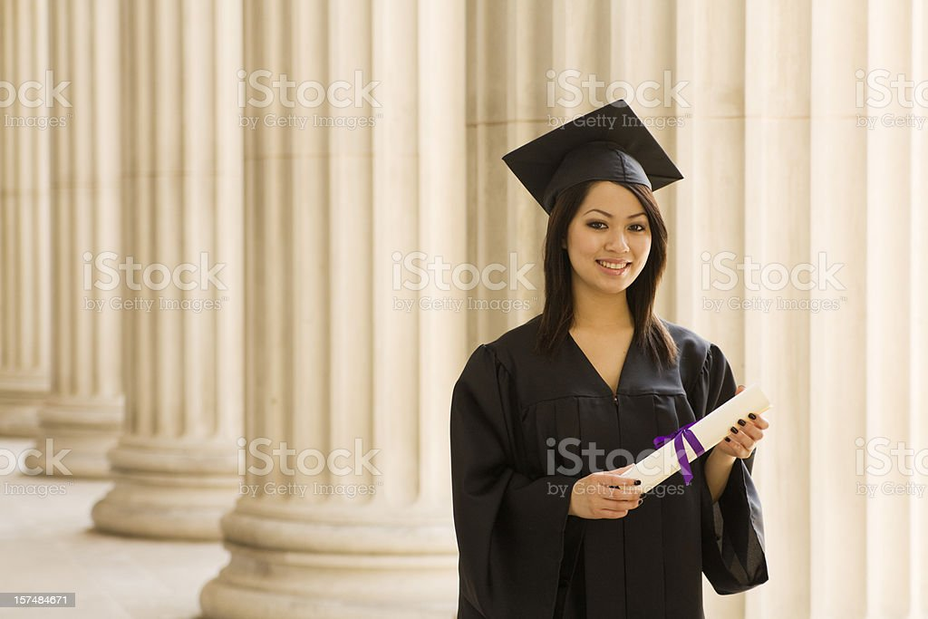 Asian Woman Student Wearing College Graduation Gown By University
